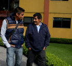 Por: Marta Molina (http://wagingnonviolence.org) Alberto Patishtan (right) smiles after receiving a special pardon. He is accompanied by his son Hector (left) and Pedro Lopez (behind)...